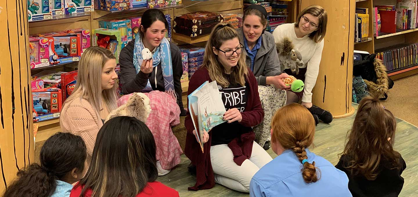 Early Education Club reads to children